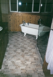 Modern Travertine Floor With Clawfoot Tub