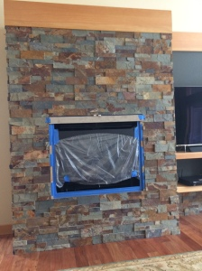 Another stacked stone fireplace