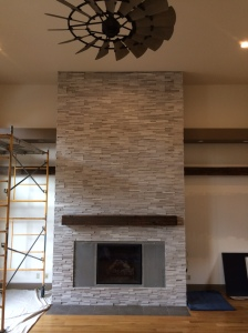 Front view of this large stacked stone fireplace